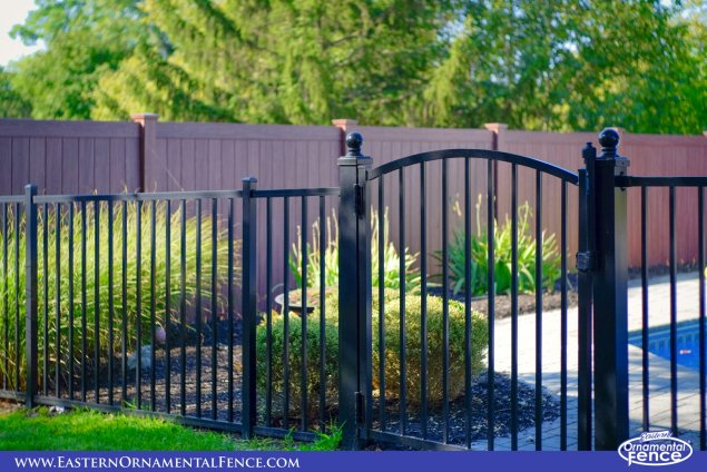eastern ornamental aluminum accent gate with pvc vinyl wood grain walnut fence from illusions fence