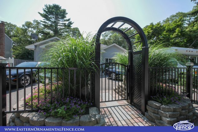 eastern ornamental aluminum accent gate with black pvc vinyl arbor from illusions fence