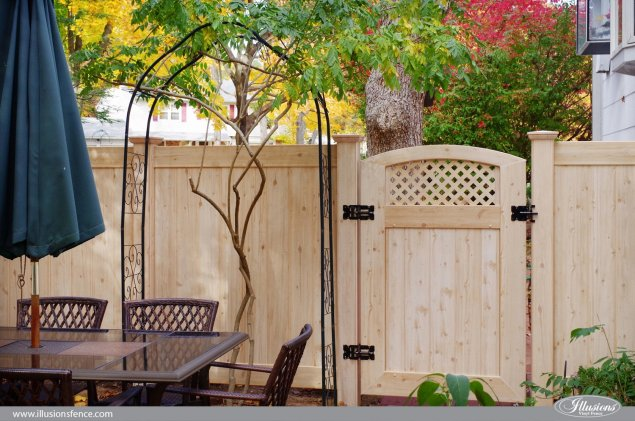 pvc vinyl wood grain accent gate shown in eastern white cedar grain from illusions fence