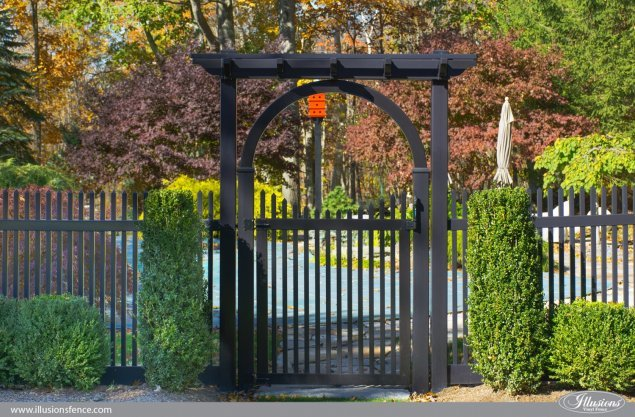 pvc vinyl gate arbor and pergola on a black picket fence from illusions fence