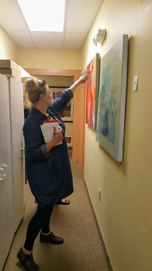 Last year's Signature Piece winner Constance Williams surveys art across the WNCAP office.