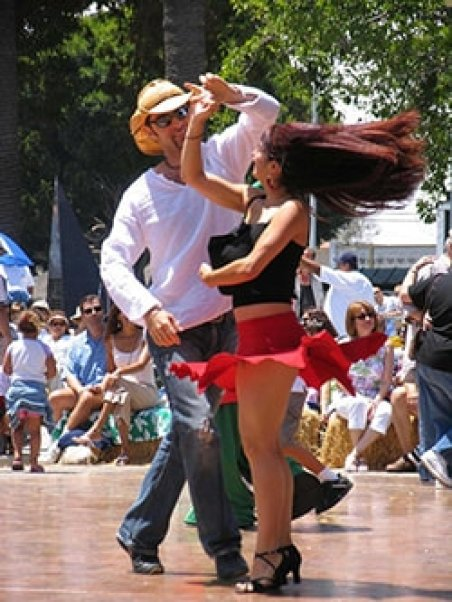 Salsa dancers at Fiesta Hendersonville, where WNCAP will have a table.